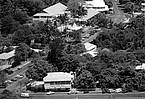 Aerial of Port Douglas in 1992 showing Macrossan and Wharf Streets