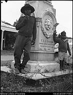 Aboriginal man and child at memorial for F D A Carstens Port Douglas Queensland April 1957